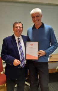 Steve Wynn receiving his LTA Lifetime Achievement Award from Essex Tennis President, Richard Lehman